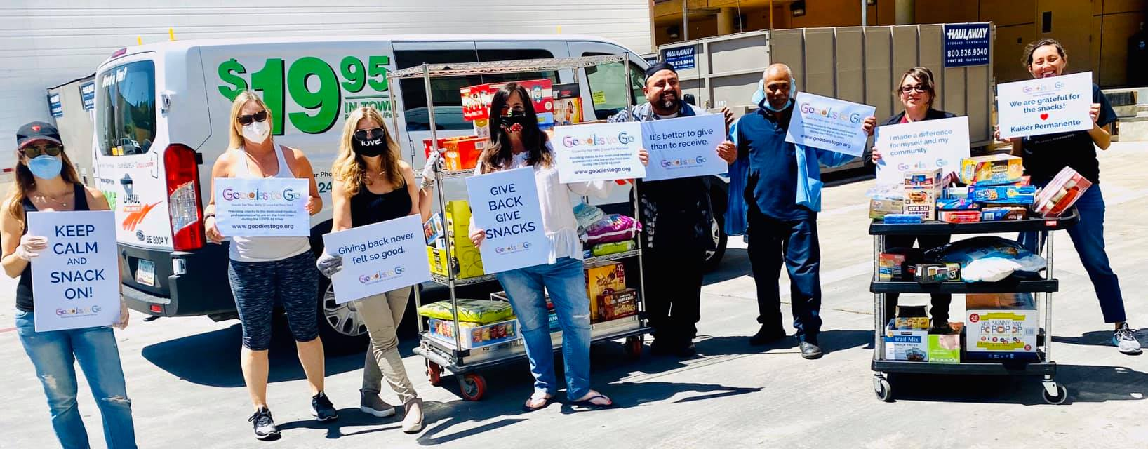 Snack Drive with signs that thank front-line workers