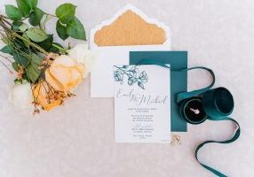Rich golds and greens are featured in this boho chic invitation suite